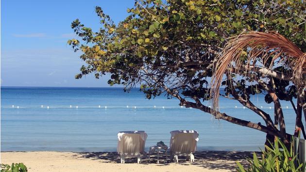Tropical beach in Jamaica and blue Caribbean sea