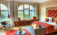 Hotel suite with red accents elephant pillows gray easy chair