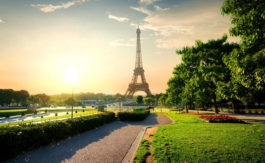 Eiffel tower near green park in Paris, France