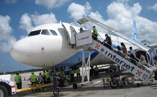 Interjet flight boarding for a Cancun departure