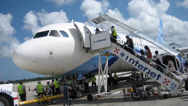 Interjet flight boarding for a Cancun departure