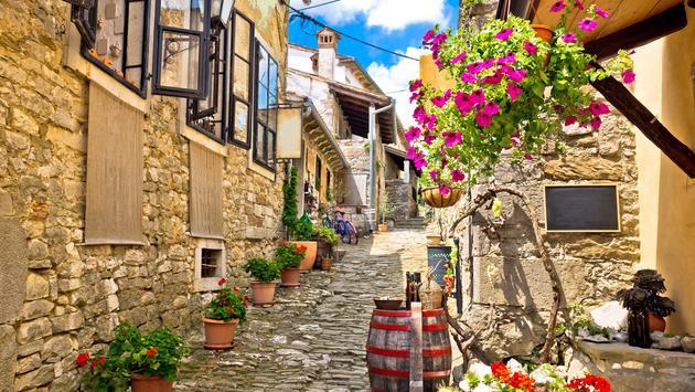 Colorful cobblestone street in Hum, Croatia.