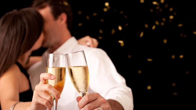 Couple Kissing and Toasting Champagne Flutes for New Year's Eve