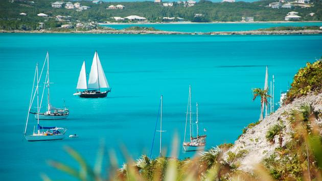 Sailboats passing Stocking Island, Exuma, The Bahamas.