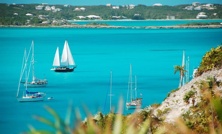 Sailboats passing Stocking Island, Exuma, The Bahamas.