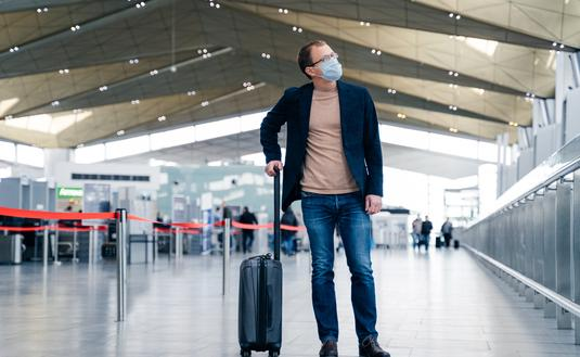 Traveler wearing a face mask at the airport