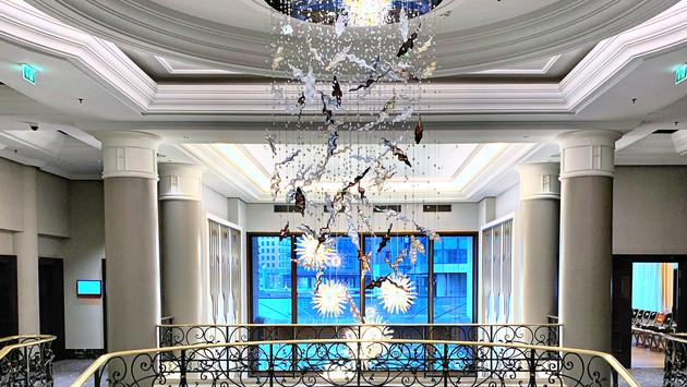 Hotel lobby with star chandelier and brass accents