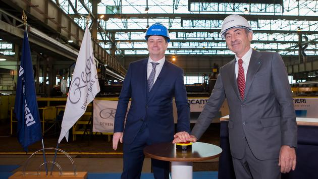 PHOTO: Jason Montague, president and CEO of Regent Seven Seas Cruises, left, pushes the button to start construction with Giovanni Stecconi, shipyard director for Fincantieri in Ancona, Italy.
