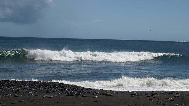 Volcanic black sand beach on Tahiti's southern coast in Papara