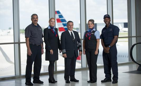 American Airlines flight attendant, pilot, maintenance, fleet service and gate agent together
