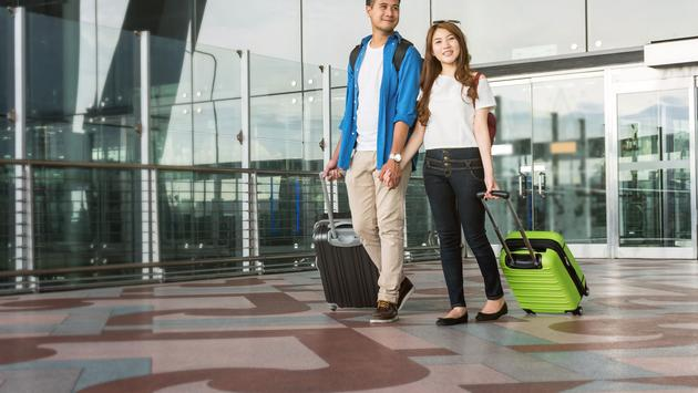 Travelers with suitcases at the airport