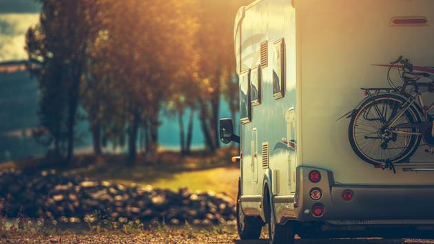 RV driving during the late afternoon in the fall.