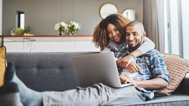 young couple on laptop