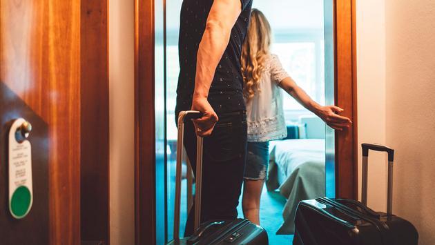 Couple walking into hotel room