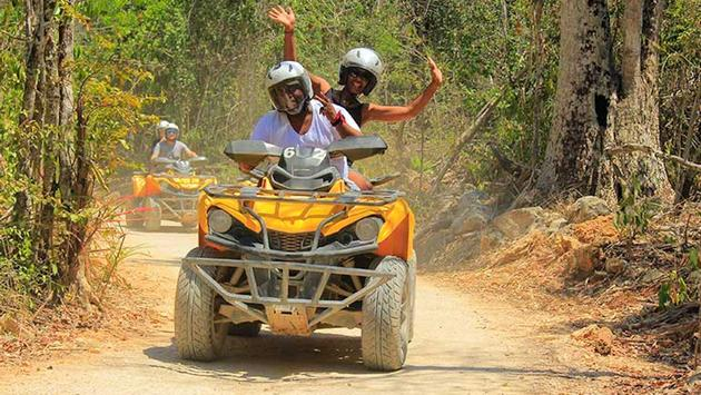Hop on the Riviera Maya's most powerful fleet of ATVs on a path through the Mexican jungle.