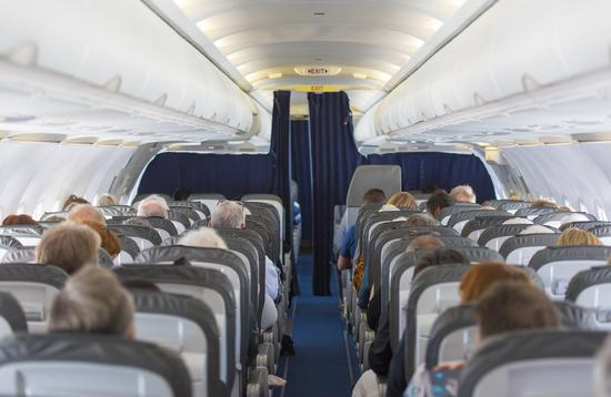Passengers seated in an aircraft cabin