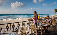 couple enjoying a meal at Hyatt Zilara Cancun