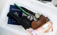 Gun in airport screening tray.