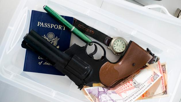 Gun in airport screening tray.