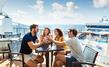 Friends enjoying cocktails at Sky High Bar aboard Norwegian Star