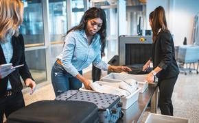 black woman, tsa, security, airport