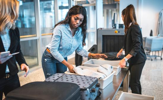 black woman, tsa, security, airport