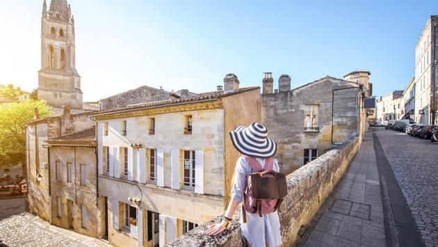 Woman traveling in Saint Emilion village, France