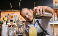 Bartender pouring a margarita at La Familia