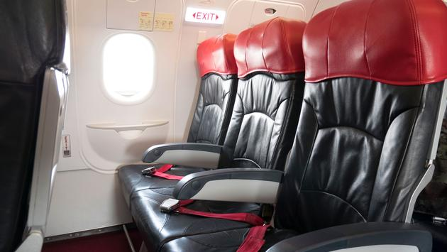 Emergency exit seat row in airplane