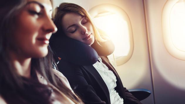 Passenger sleeping on neck cushion