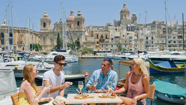 People enjoying food in Birgu, Malta.
