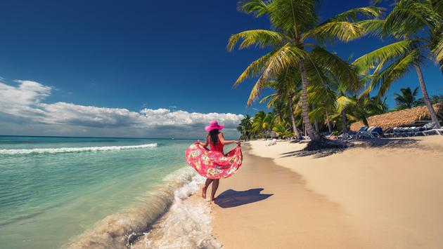 Woman walking on the beach in the Dominican Republic
