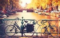 Bikes on the bridge in Amsterdam, Netherlands, Europe. (Photo via NataliaDeriabina / iStock / Getty Images Plus)