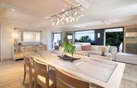Interior of suite at Espacio in Waikiki with white accents and modern furnishings