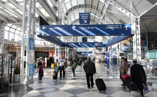 Travelers walking through Chicago's O'Hare International Airport