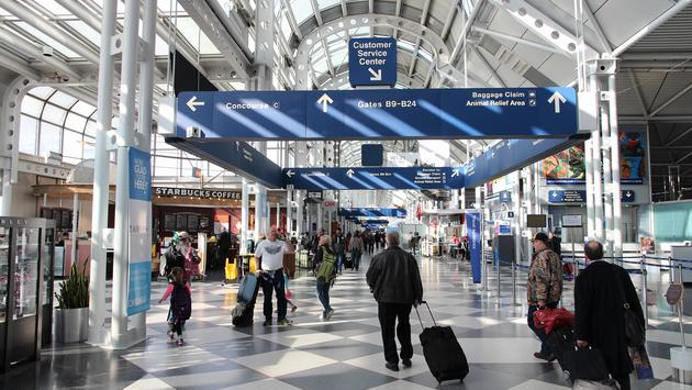 Travelers walking through Chicago's O'Hare International Airport