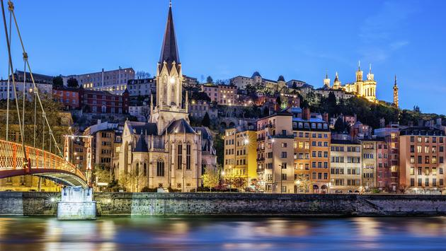 Nighttime cityscape of Lyon, France from the Saone River