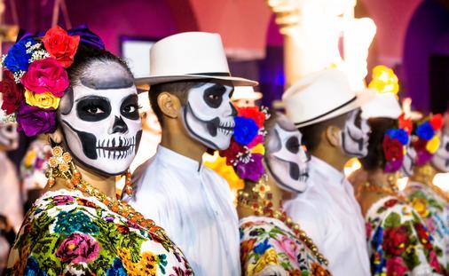 Painted dancers on Dia de Muertos in Merida, Yucatan, Mexico.