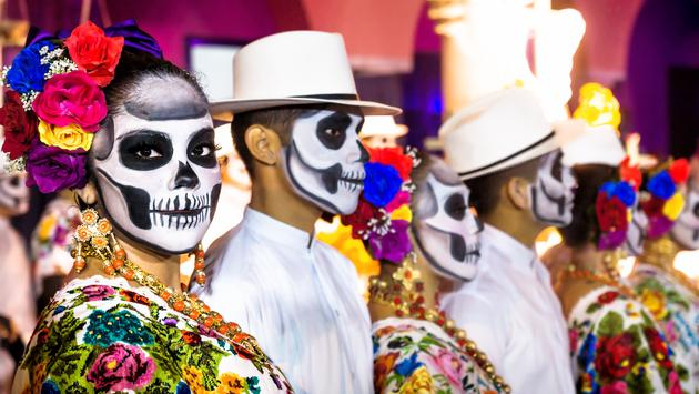 Painted dancers on Dia de Muertos in Merida, Yucatan, Mexico.