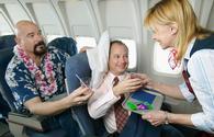Annoying passenger demands flight attendant's attention