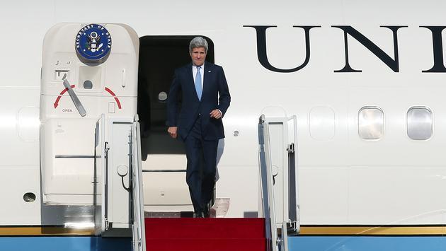 Former Secretary of State John Kerry deplanes upon landing at Seoul Air Base in 2015
