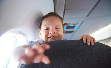 Smiling child on an airplane