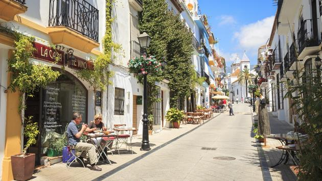 A side street with restaurants and bars in Marbella, Spain