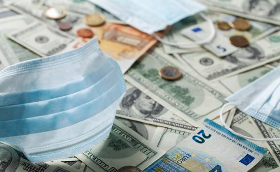 Medical face mask and money from around the world.