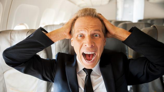 Screaming man on plane