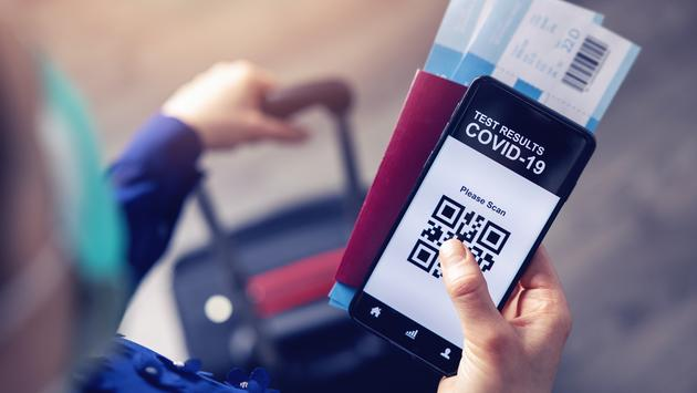 Mobile app displaying QR code linked to traveler's COVID-19 test results.
