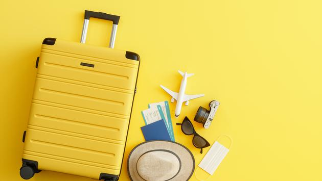 Medical Mask, Suitcase with Sun Hat, Camera, Passport, Airplane Ticket, Sunglasses and Airplane