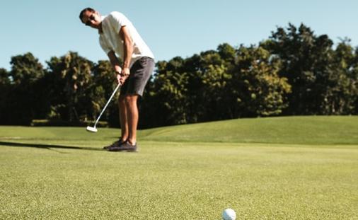 Man golfing at a Hard Rock golf club