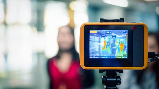 Infrared thermal camera monitoring the temperatures of passersby.
