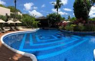 The adults-only pool at Waves Hotel & Spa is adjacent to the spa and is a quiet respite from the beach.